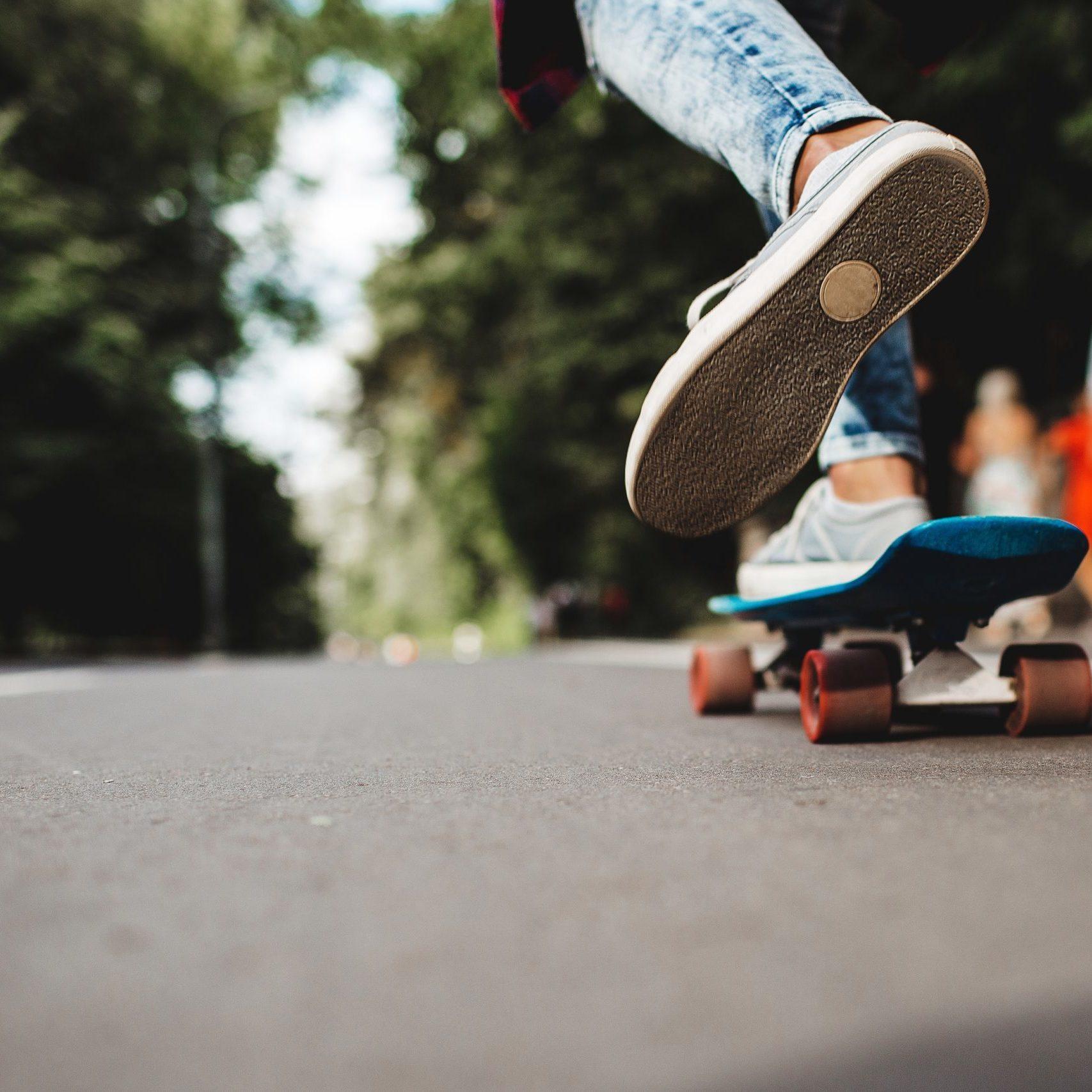 girl riding a skateboard in a city park